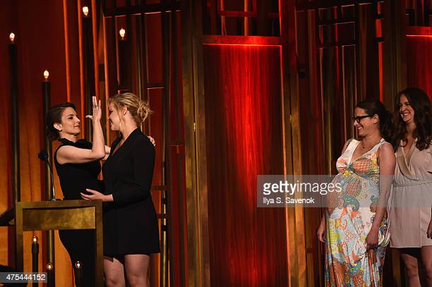 Comedians Tina Fey and Amy Schumer kiss onstage at The 74th Annual Peabody Awards Ceremony at Cipriani Wall Street on May 31 2015 in New York City