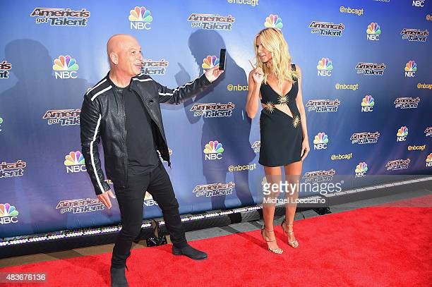 Comedian/TV personality Howie Mandel takes a picture of model/TV personality Heidi Klum before the 'America's Got Talent' season 10 taping at Radio...