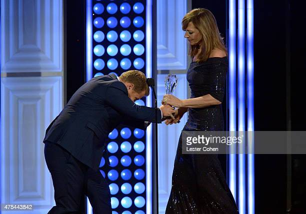Comedian/TV personality James Corden bows to actress Allison Janney as he presents her with the Best Supporting Actress award for 'Mom' onstage at...