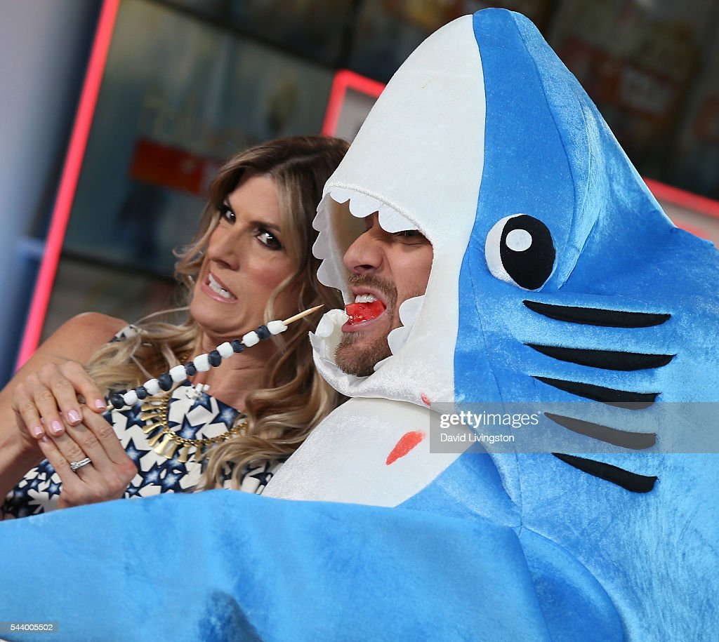 Comedian/TV personality Trish Suhr and host Tanner Thomason (in shark suit) attend Hollywood Today Live at W Hollywood on June 30, 2016 in Hollywood, California.