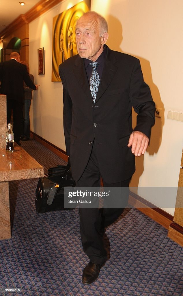 Co-mediator Heiner Geissler departs after a press conference with representatives of the German union of locomotive drivers, the GDL, and German rail carrier Deutsche Bahn at the Park Inn hotel August 28, 2007 in Berlin, Germany. The two sides announced they had found enough common ground to reach an agreement in their current labour dispute, which is centered on wages.