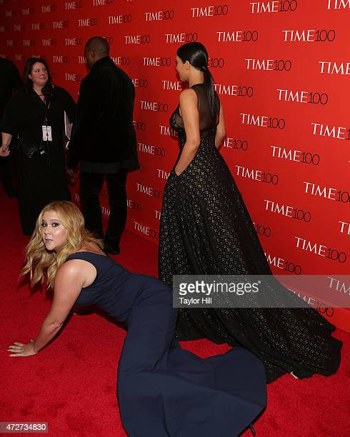 Comedienne Amy Schumer prostrates herself in front of Kim Kardashian and Kanye West at the 2015 Time 100 Gala at Frederick P Rose Hall Jazz at...