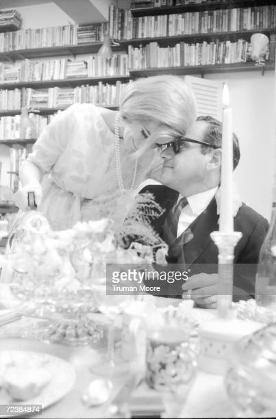 Comedienne Joan Rivers kissing her husband producer Edgar Rosenberg while serving him tea [Scanned from contact sheet]