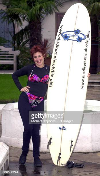 TV comedienne Ruby Wax holding a surfboard in Kensington London to launch the new internet HIV information service run by NHS Direct Online on World...