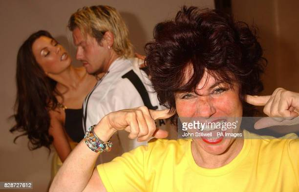 Comedienne Ruby Wax tries to shut out the noise as 'Posh and Becks' lookalikes Andy Harmer and Camilla Shadbolt simulate a loud session of lovemaking...