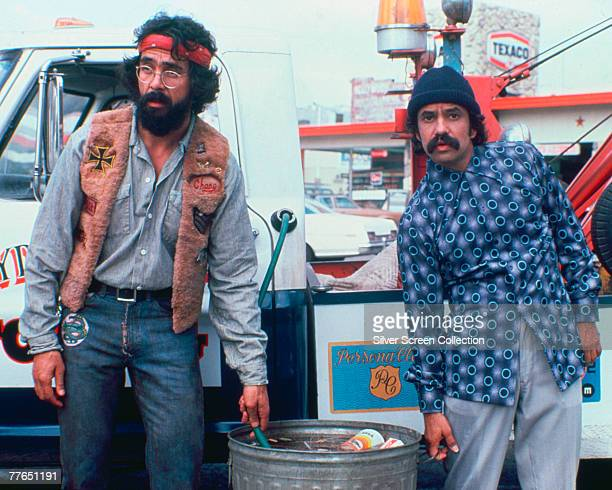 Comedy duo Cheech and Chong syphon petrol into a rubbish bin in a scene from 'Cheech Chong's Next Movie' 1980