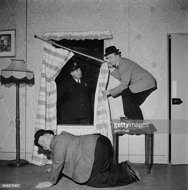 Comedy duo Stan Laurel and Oliver Hardy botch a buglary in the sketch 'A Spot Of Trouble' performed on stage during their tour of the UK 25th...