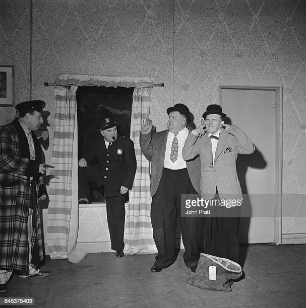 Comedy duo Stan Laurel and Oliver Hardy botch a burglary in the sketch 'A Spot Of Trouble' performed on stage during their tour of the UK 25th...
