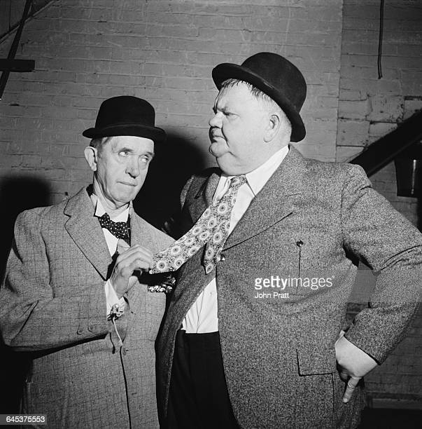 Comedy duo Stan Laurel and Oliver Hardy perform the sketch 'A Spot Of Trouble' on stage during their tour of the UK 25th February 1952 The plot was a...