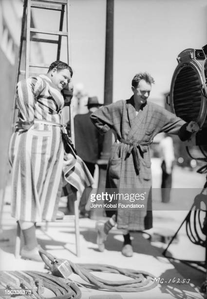 Comedy team Oliver Hardy and Stan Laurel on their set of one of their films circa 1930