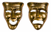 Classical theatrical gold drama masks isolated on white