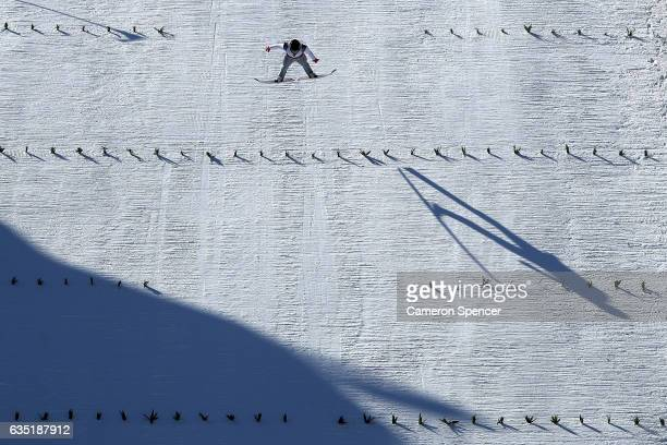 A comepetitor ski jumps during unofficial training at the Alpensia Ski Jump prior to the 2017 FIS Ski Jumping World Cup test event For PyeongChang...