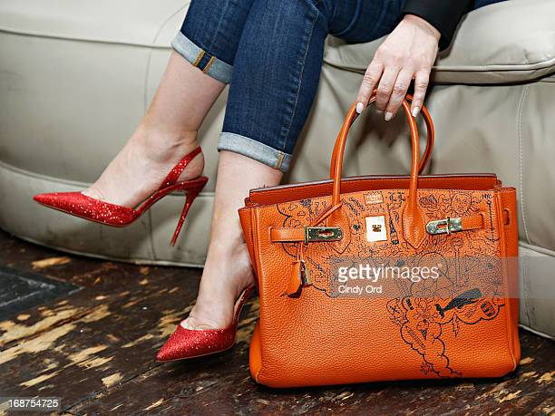 Comes With Baggage Founder Lori Levine shows off her oneofakind orange Hermès Birkin at the Comes With Baggage Fashion Editor Preview on May 14 2013...