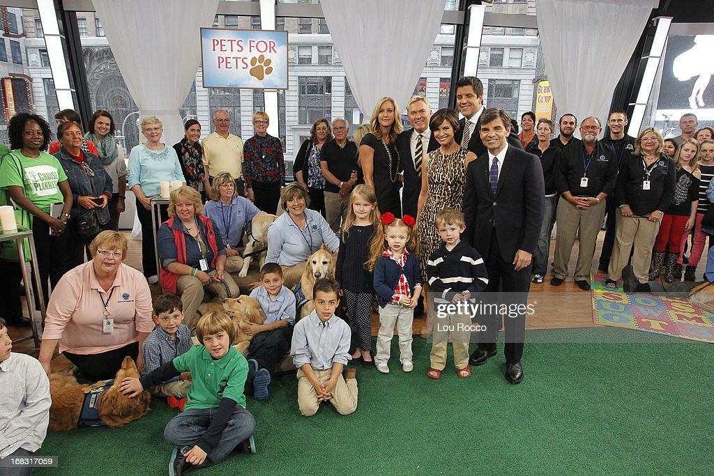 Comfort Dogs Surprised guests on 'Good Morning America,' 5/8/13, airing on the ABC Television Network. (Photo by Lou Rocco/ABC via Getty Images) AUDIENCE, DOG HANDLERS, LARA SPENCER, SAM CHAMPION, ELIZABETH VARGAS, JOSH ELLIOTT, GEORGE STEPHANOPOULOS