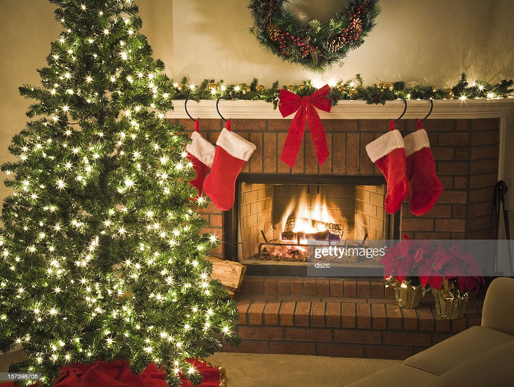 gold theme christmas eve tree fireplace stockings gifts mantel