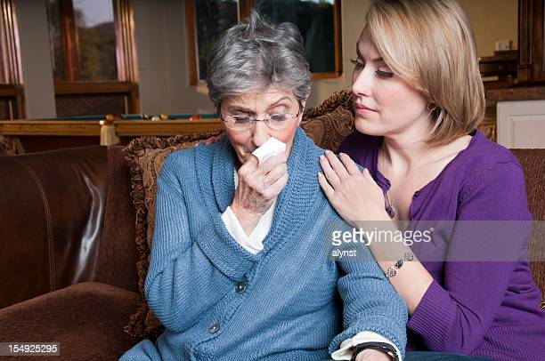 Comforting Elderly Woman in a Crisis