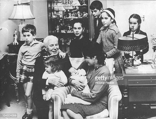 Comic actor Charlie Chaplin with his wife Oona O'Neill and their children including newborn Annette at their home the Manoir de Ban Switzerland...