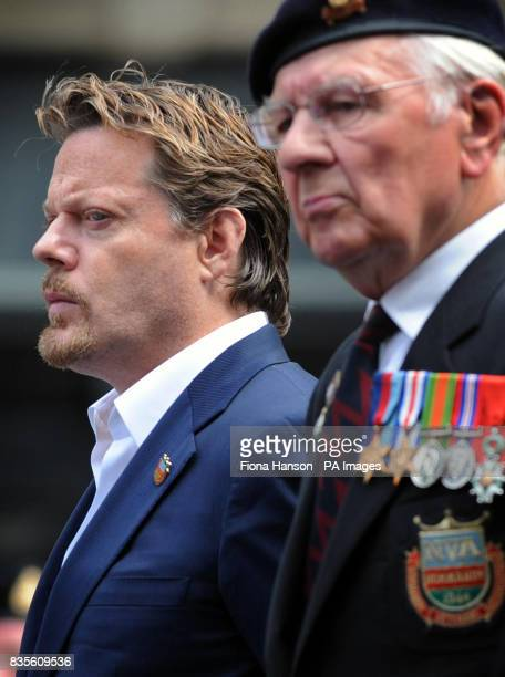 Comic actor Eddie Izzard accompanies members of the Normandy Veterans' Association laying wreaths at the Cenotaph in Whitehall central London marking...