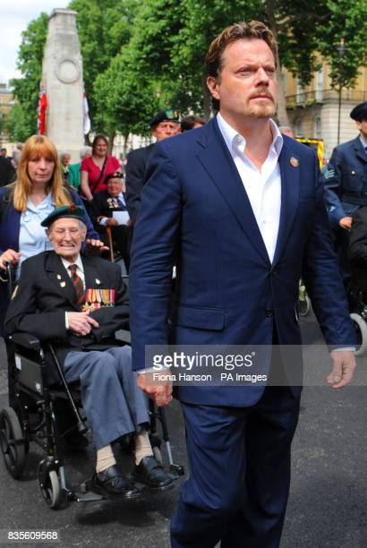 Comic actor Eddie Izzard accompanies members of the Normandy Veterans' Association wreath laying ceremony at the Cenotaph in Whitehall central London...
