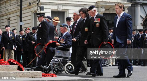 Comic actor Eddie Izzard accompanies members of the Normandy Veterans' Association as they lay wreaths at the Cenotaph in Whitehall central London...