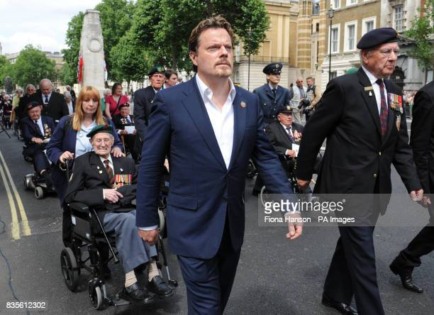 Comic actor Eddie Izzard accompanies members of the Normandy Veterans' Association after a wreath laying ceremony at the Cenotaph in Whitehall...