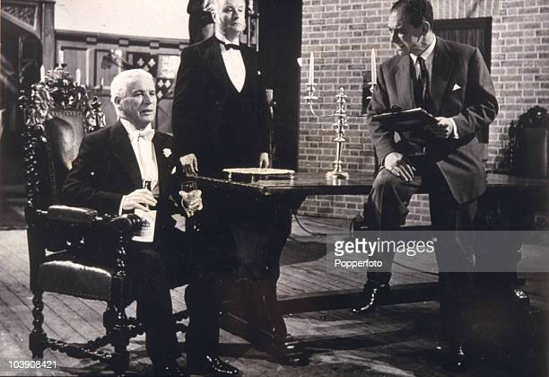 Comic actors Charlie Chaplin and Sid James during the making of 'A King In New York' 1957 Chaplin who directed is in his last leading role