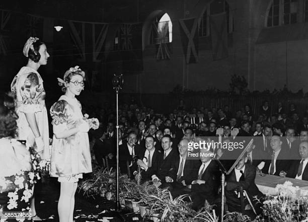 Comic actresses Ethel Revnell and Gracie West entertaining serviceman after tea at a garden party as part of the 'Not Forgotten' Association at...