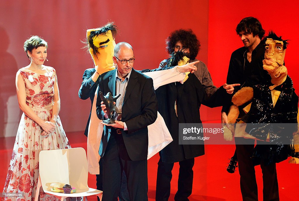 Comic artist Reinhard Kleist (2nd R) on stage with puppet comedians 'the Helmi' as he receives his award at the B.Z. Kulturpreis on January 18, 2013 in Berlin, Germany.