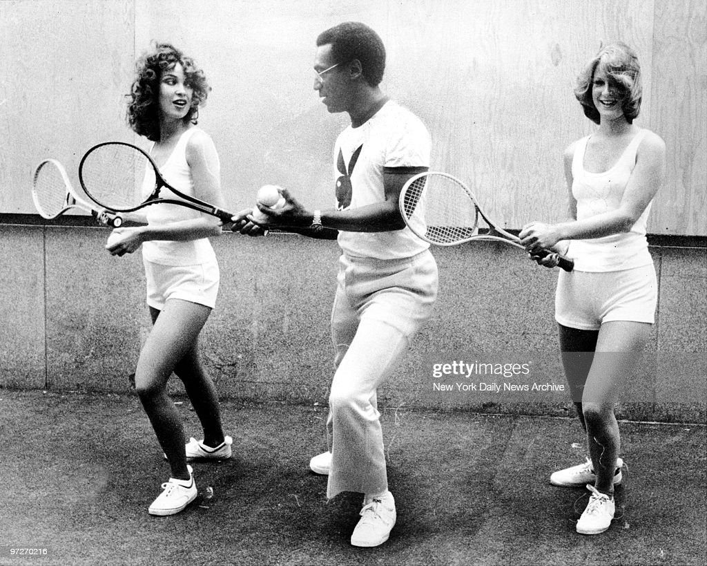 ic Bill Cosby gives a tip or two on tennis to bunnies Jan