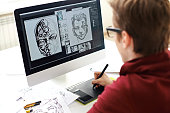 Skilled comic artist creating comic book on computer