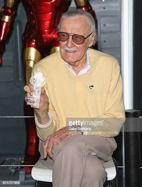 Comic book icon Stan Lee holds up his ceremonial key to the Las Vegas Strip at Marvel Avengers STATION at the Treasure Island Hotel Casino on...