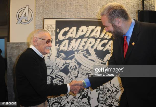 Comic Book Icon Stan Lee with David Baxter of Legion M is presented with Jack Kirby Captain American original art at his 95th Birthday House Party...