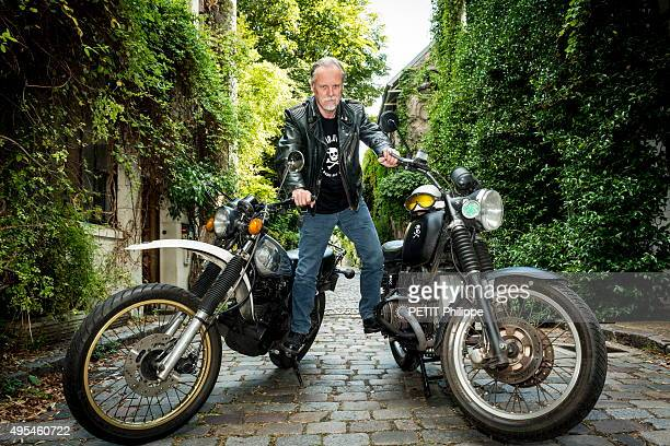 comic book writer and illustrator Franck Magerin with his motorcycles poses on july 30 in Paris France
