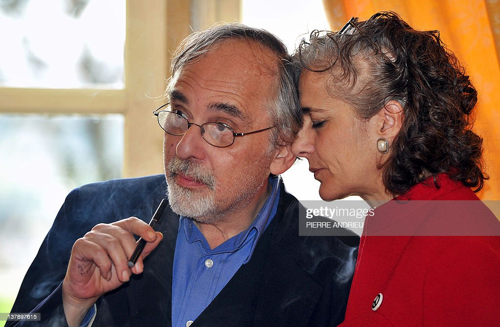 US comic book writer Art Spiegelman (L) and his wife Françoise Mouly (R) are pictured during a ceremony as part of the 39th edition of Angouleme world comic strip festival, on January 29, 2012 in Angouleme, southwestern France.