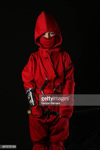 Comic Con attendee Ansel Barnard poses as The Red Ninja Ranger from Mighty Morphin Power Rangers during the 2014 New York Comic Con at Jacob Javitz...