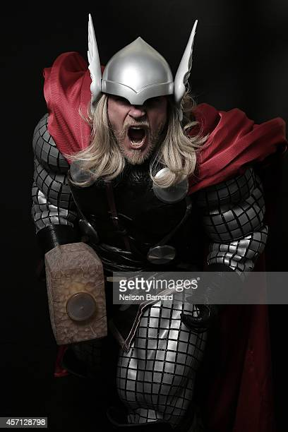 Comic Con attendee Mark Smith poses as Thor during the 2014 New York Comic Con at Jacob Javitz Center on October 12 2014 in New York City
