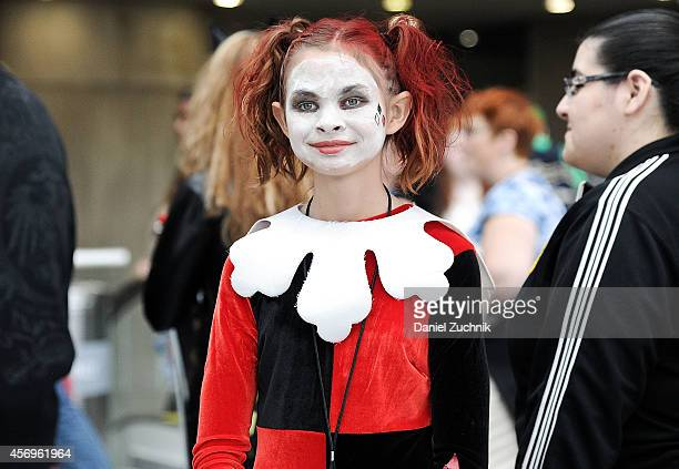 Comic Con attendee poses as Harley Quinn during the 2014 New York Comic Con at Jacob Javitz Center on October 9 2014 in New York City