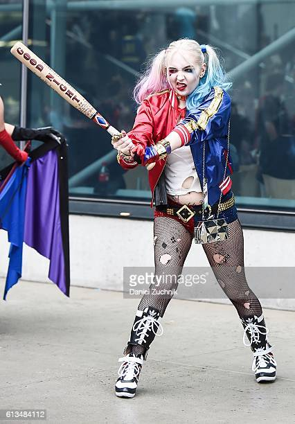Comic Con attendee poses as Harley Quinn during the 2016 New York Comic Con Day 3 on October 8 2016 in New York City