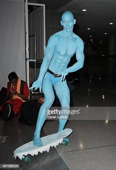 Comic Con attendee poses as Silver Surfer during the 2014 New York Comic Con at Jacob Javitz Center on October 11 2014 in New York City