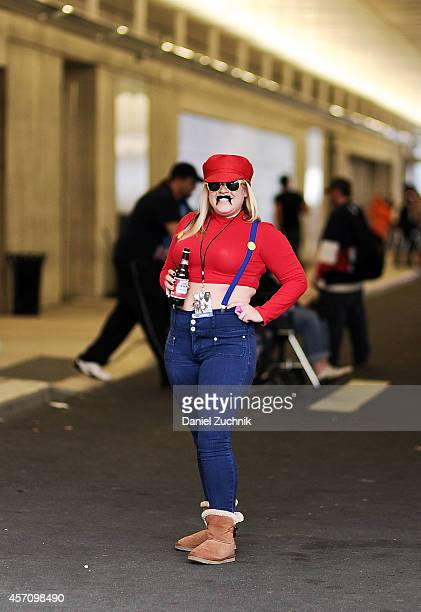 Comic Con attendee poses as Super Mario during the 2014 New York Comic Con at Jacob Javitz Center on October 11 2014 in New York City