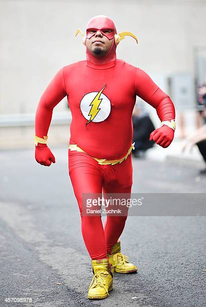 Comic Con attendee poses as The Flash during the 2014 New York Comic Con at Jacob Javitz Center on October 11 2014 in New York City