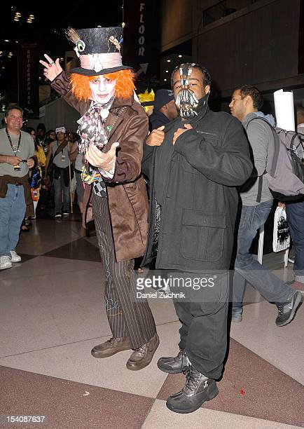 Comic Con attendees are wearing a Mad Hatter and Bain costumes during the 2012 New York Comic Con at the Javits Center on October 12 2012 in New York...