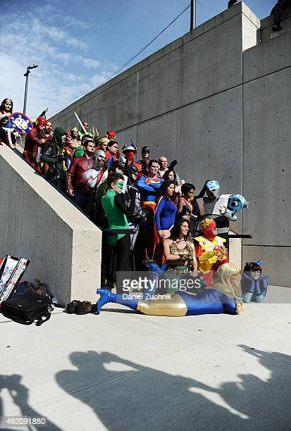 Comic Con attendees pose as Justice League members during New York ComicCon 2015 at The Jacob K Javits Convention Center on October 9 2015 in New...