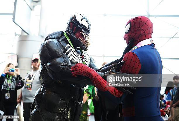 Comic Con attendees pose as Venom and Spiderman during New York ComicCon 2015 at The Jacob K Javits Convention Center on October 11 2015 in New York...