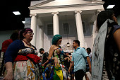 Comic Con conventioners walk past a replica White House featured to promote the ABC television show 'Designated Survivor' at the San Diego Convention...