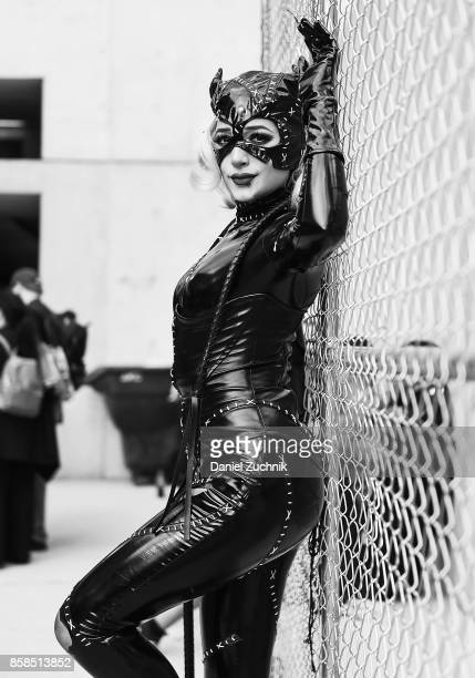 A Comic Con cosplayer dressed as Catwoman poses during the 2017 New York Comic Con Day 2 on October 6 2017 in New York City