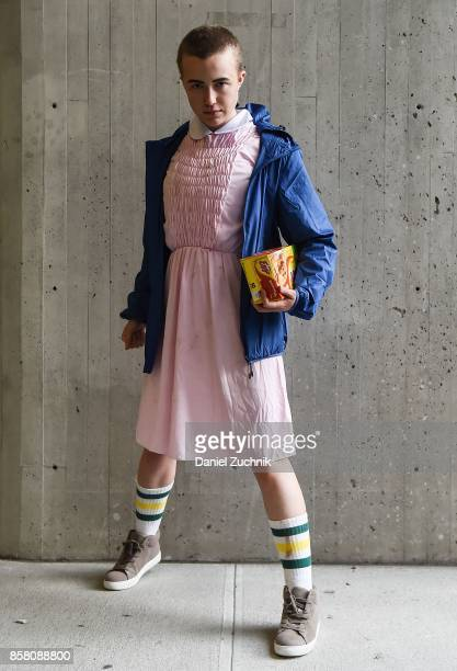 Comic Con cosplayer dressed as Eleven from 'Stranger Things' poses during 2017 New York Comic Con Day 1 on October 5 2017 in New York City