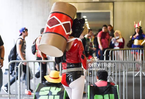 Comic Con cosplayer dressed as Harley Quinn poses during the 2017 New York Comic Con Day 3 on October 7 2017 in New York City