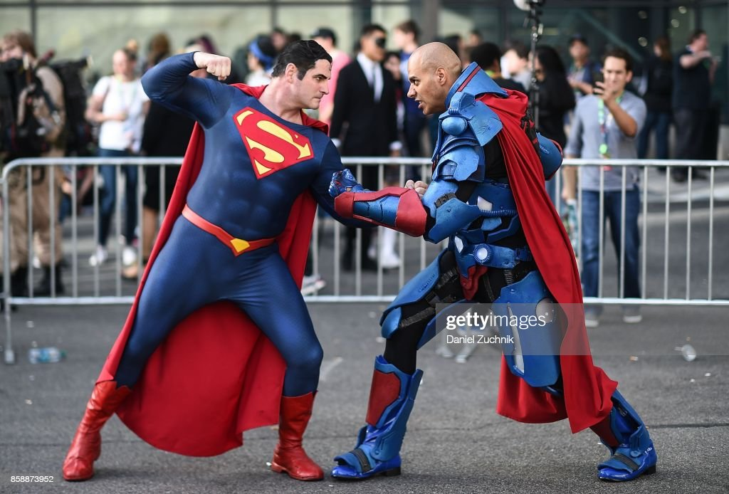 Comic Con cosplayers dressed as Superman pose during the 2017 New York Comic Con - Day 3 on October 7, 2017 in New York City.