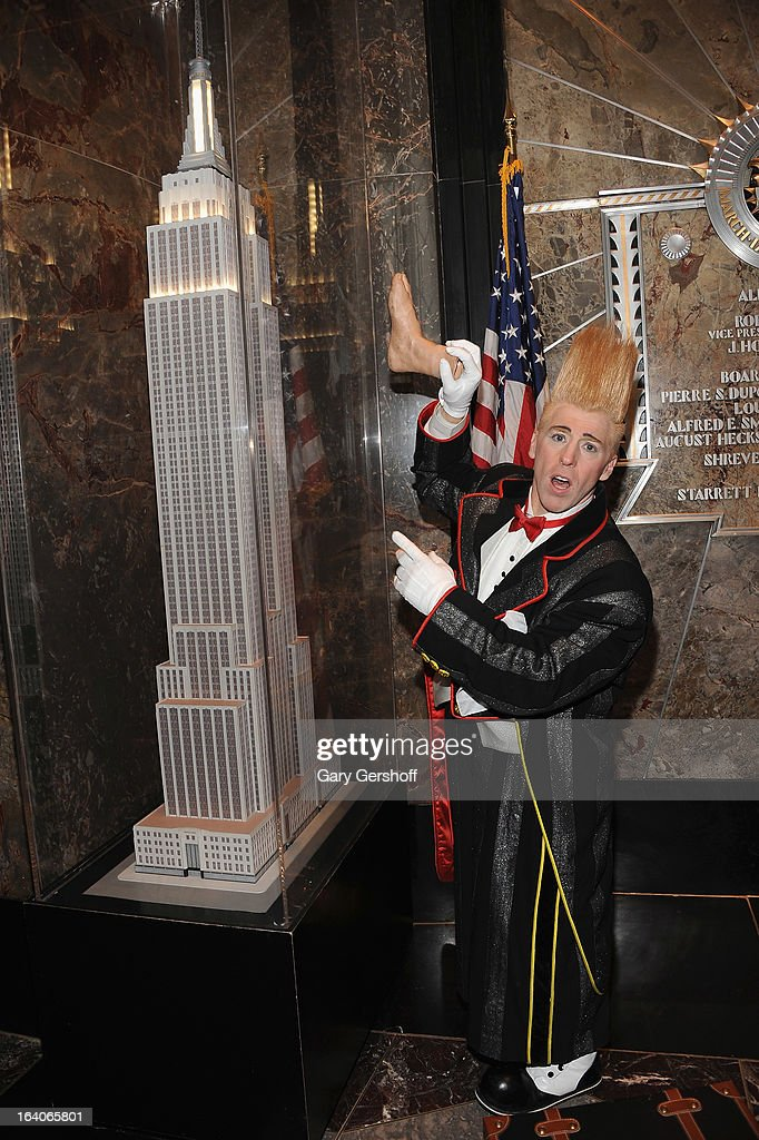Comic daredevil <a gi-track='captionPersonalityLinkClicked' href=/galleries/search?phrase=Bello+Nock&family=editorial&specificpeople=2526765 ng-click='$event.stopPropagation()'>Bello Nock</a> visits The Empire State Building on March 19, 2013 in New York City.